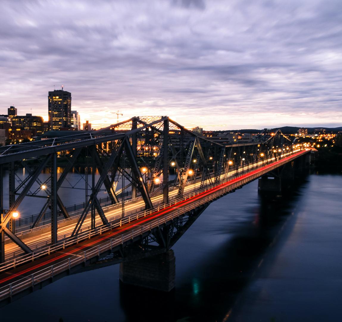 Long exposure shot of city bridge in evening
