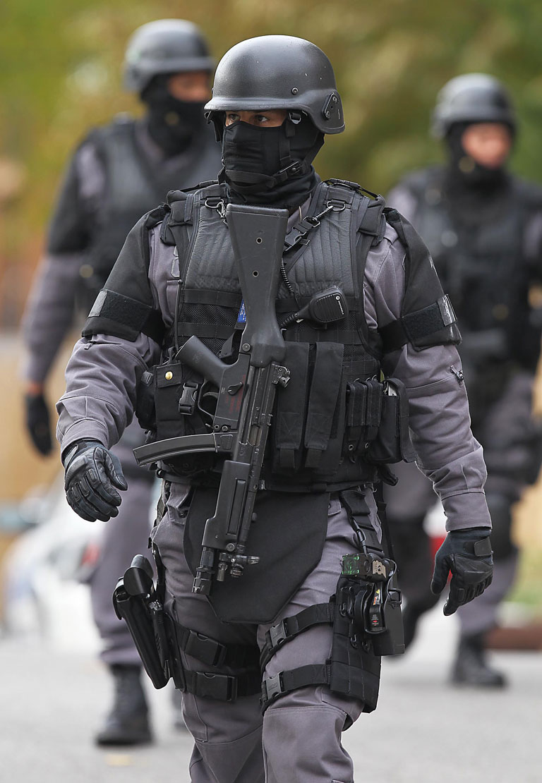 A Canadian Police officer - the new domestic army.
